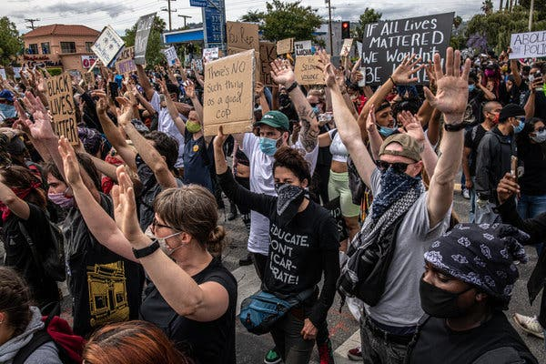 Protesters against the killing of George Floyd marching in Los Angeles last month.  Polls show a surge of support for the Black Lives Matter movement.