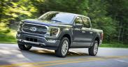 a car parked on the side of a road: 2021 F-150 Limited